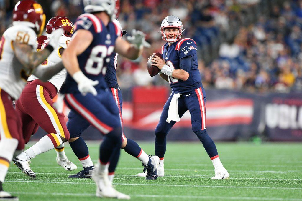 New England Patriots quarterback Mac Jones 10) looks to throw against the Washington Football Team during the second half of a preseason game at Gillette Stadium