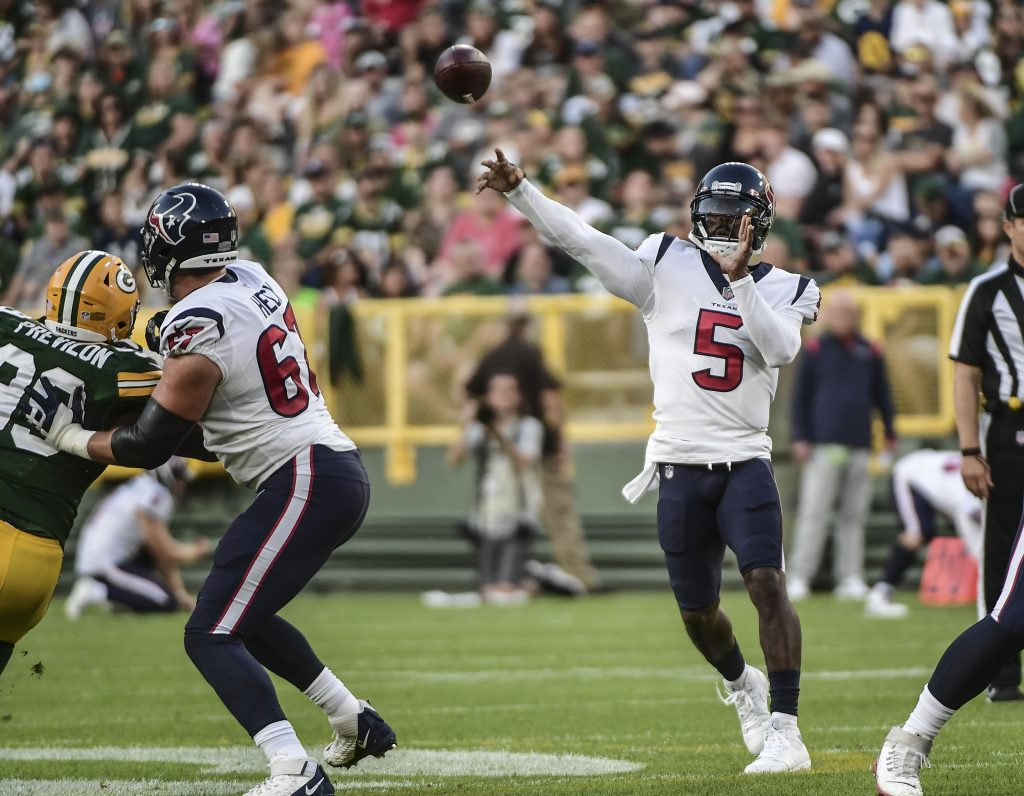 Houston Texans quarterback Tyrod Taylor (5) throws a pass against the Green Bay Packers in the first quarter during the game at Lambeau Field preseason
