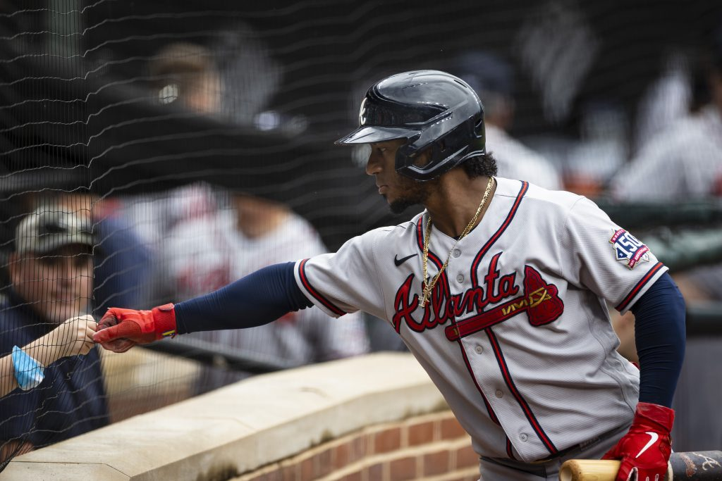 Atlanta Braves second baseman Ozzie Albies (1) first bumps a young fan during the first inning against the Baltimore Orioles at Oriole Park at Camden Yards