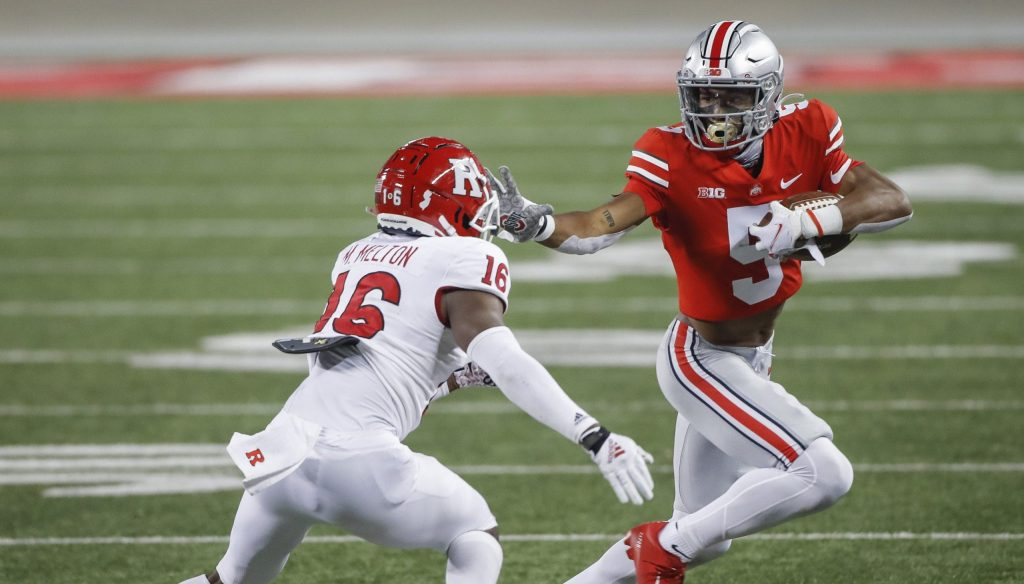Garrett Wilson (5) teams with Chris Olave to give Ohio State one of the nation's best receiving duos. Ohio State Buckeyes Football Faces The Rutgers Scarlet Knights