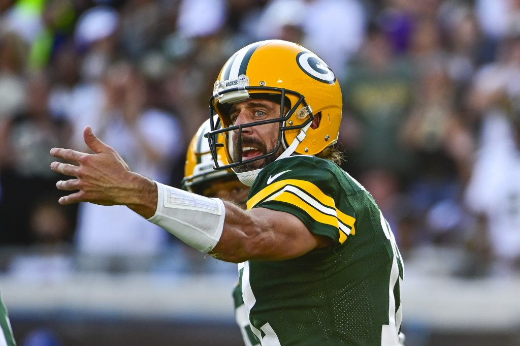 Green Bay Packers quarterback Aaron Rodgers (12) directs teammates during the second half against the New Orleans Saints at TIAA Bank Field.