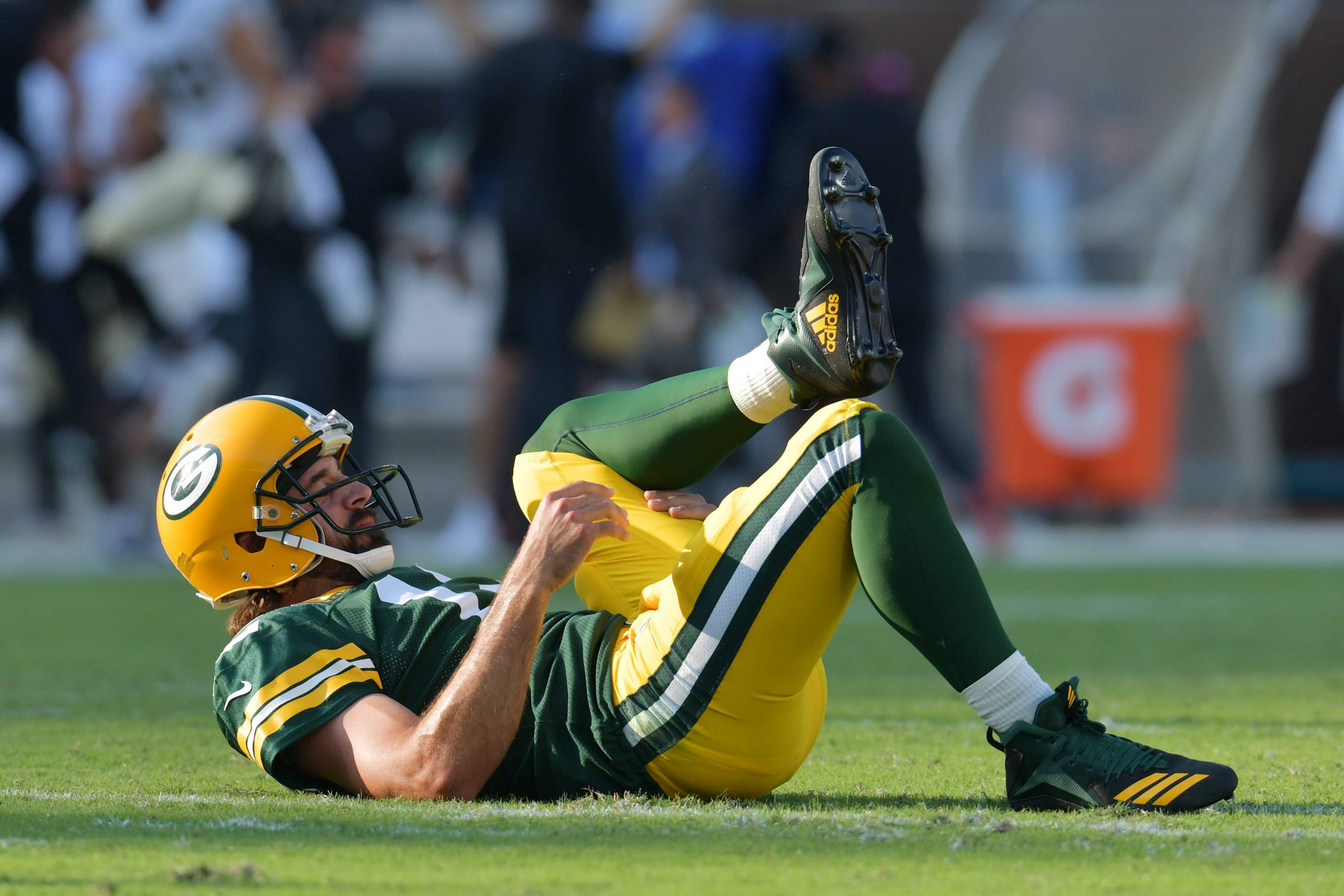 Green Bay Packers quarterback Aaron Rodgers (12) on the turf after throwing a pass that was intercepted by New Orleans Saints cornerback Paulson Adebo (29) during early third quarter action.
