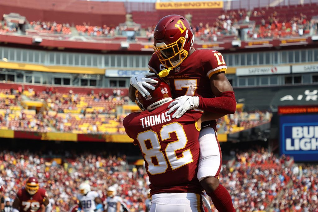 Washington Football Team tight end Logan Thomas (82) celebrates with Washington Football Team wide receiver Terry McLaurin (17) after catching a touchdown pass against the Los Angeles Chargers.